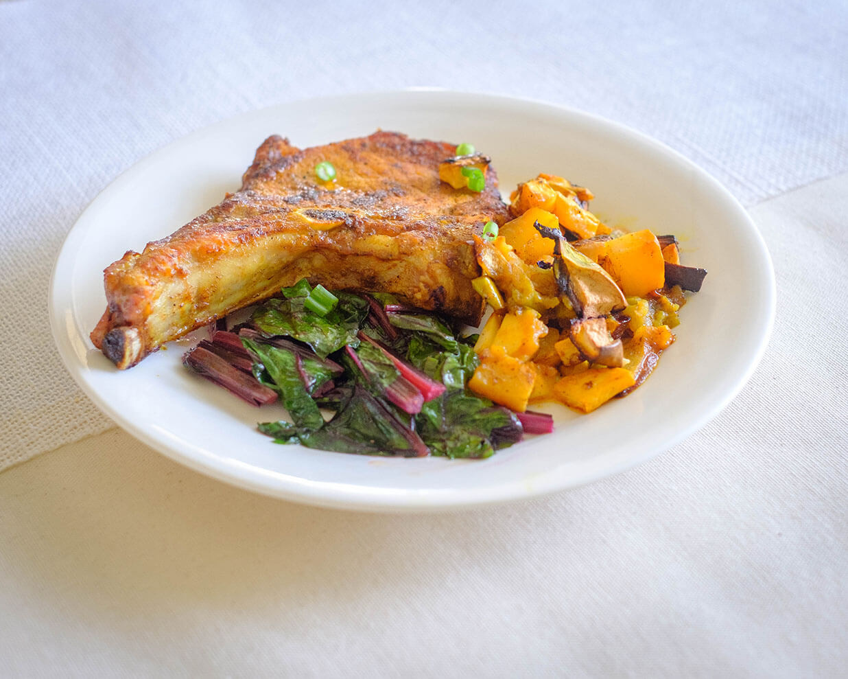 pork chops and beet leaves